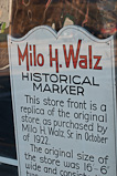 Sign in window of former Milo H. Walz store